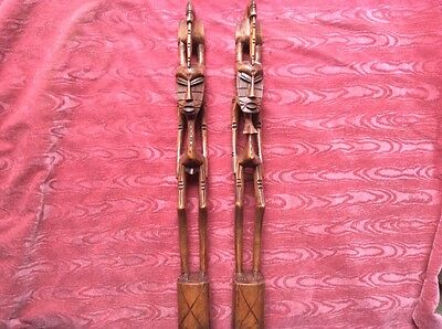 Pair of African carved wood figures.and one other