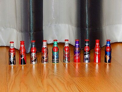 100 years of the Coca Cola bottle ( 10 mini aluminium bottles ) LAST