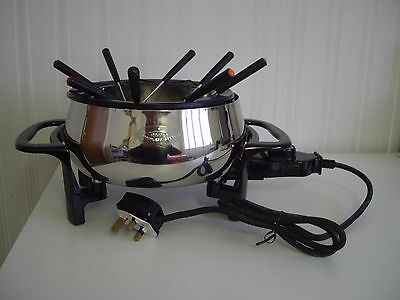 RIVAL Electric Stainless Steel Fondue Pot - 3 litre capacity - 8 forks. UNUSED