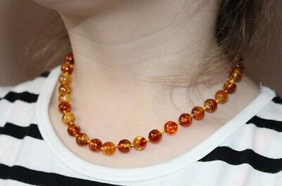 Baltic Amber Baby Necklaces perfectly Rounded Baroque Mosaic / variegated