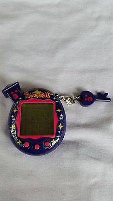 Tamagotchi v5 (purple, collectable, working)