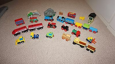 Collection of Brio and Early learning centre trucks, lorries and trains