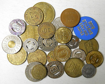 Mystery lot of 25 different transit tokens.