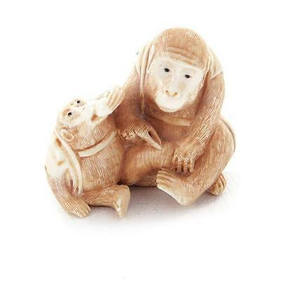Japanese carved and stained monkey netsuke, signed Lot 1153