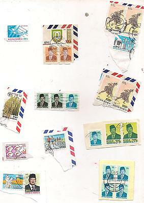 24 INDONESIA stamps on paper.