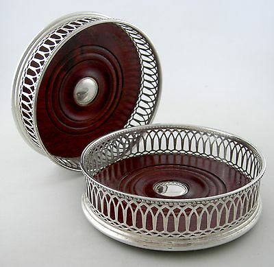 English Sterling and Mahogany wine coasters (pair)