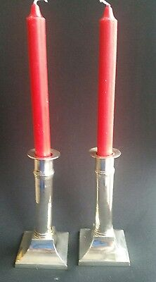 a pair of elegant silver plated candlesticks
