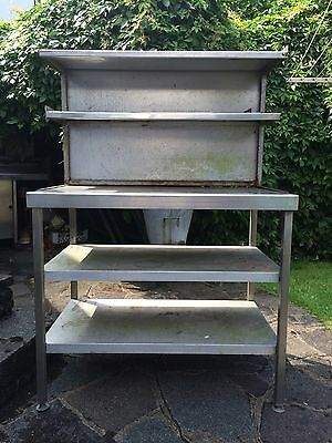 A Stainless Still Catering Work Table Stand With Shelfs