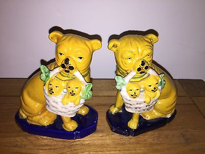Pottery Pair Of Staffordshire ?  Dogs  With Basket Of Puppies In Mouth