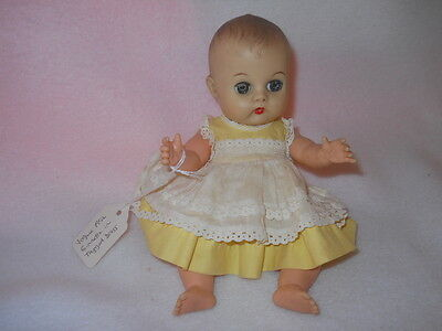 Vintage 1950s Vogue Ginnette Doll with Original tagged dress