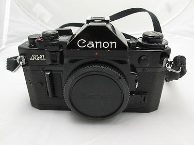 Canon A1 SLR 35mm Camera w/various Mounts & Lens Kit/Bag + extras