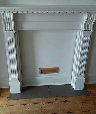 white wooden fire surround