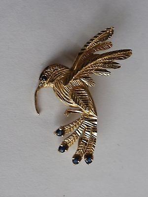 Sweet little hummingbird brooch 9carat gold set with emeralds   Comes boxed vgc.