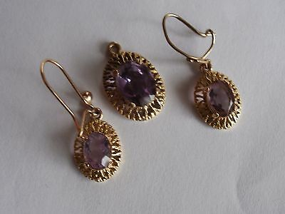 9carat gold amethyst earrings and pendant set,  in a vgc will come boxed.