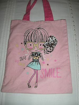 Girls Pink material bag good used condition