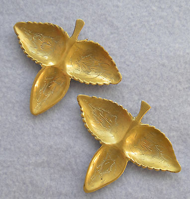 A pair of three-leaf brass dishes