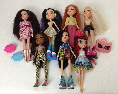 Bratz Doll Lot of 7 Dolls Mixed LOT w/ Clothes and Accessories Clean Barbie Type
