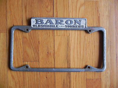 RARE VINTAGE1950'S New York YONKERS License Plate Frame BARON OLDSMOBILE
