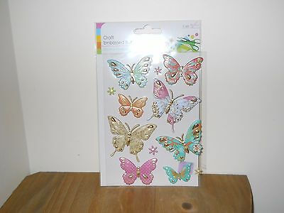 1 Brand New Pack Of 8 Butterfly Embellishments In Assorted Colours.
