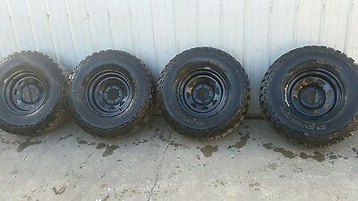 Black 4x4 rims and mud tyres