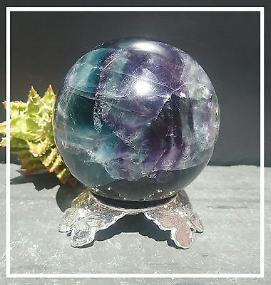 Fluorite gemstone sphere with rainbows on silver butterfly  stand