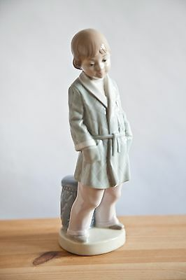LLADRO.Young boy in dressing gown