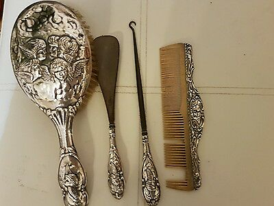 Silver  four piece dressing table set, brush, comb,button hook , shoehorn
