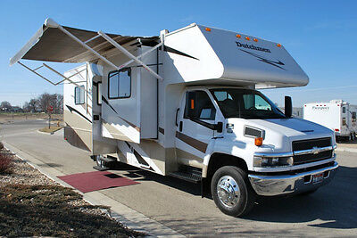Dutchmen Diesel Super C Duramax 33' Class C RV Triple Slideout King Bed, 10k tow