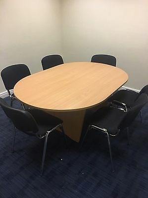 Beech oval meeting room table with panel legs
