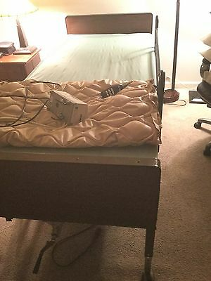 hospital bed with air pump and mattress in great condition