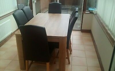 oak effect dining table and chairs