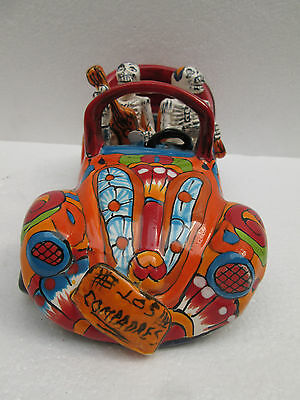 TALAVERA CATRINA 70s hippie  vw beetle  friends in car   mexican day of the dead