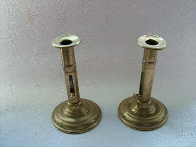 Pair of antique brass candle sticks.