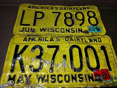 1980s Yellow black State of Wisconsin License Plates