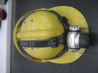 CHILD'S CAVING HELMET SUITABLE FOR A BEGINNER YELLOW with lamp and battery.