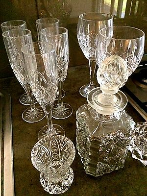 crystal glasses and decanter, small vase and candle stick holder