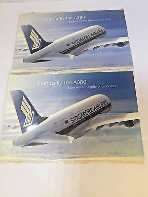 "Lot of 2 SINGAPORE AIRLINES SIA SQ ""First To Fly The A380"" Postcards New Sealed"