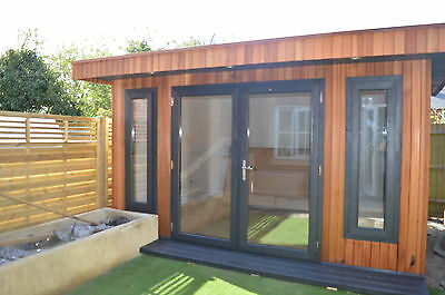 Garden Office. Room.Studio. cedar face walls.100mm insulated and installed