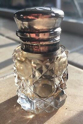 Silver topped glass scent bottle