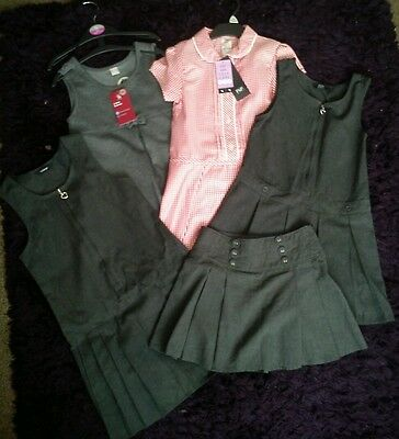 Girls uniform bundle new and used age 5-6 years. Dress skirt tops etc
