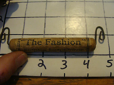 "vintage advertising: bag handle, ""THE FASHION"" Falconer NY, paper over wood"