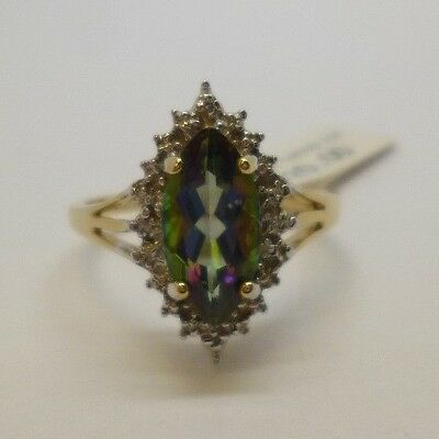 This is a beautiful 9ct gold diamond shape mystic topaz and diamond ring