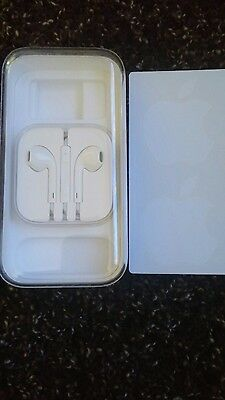 iphone 5c empty box with ear buds and stickers