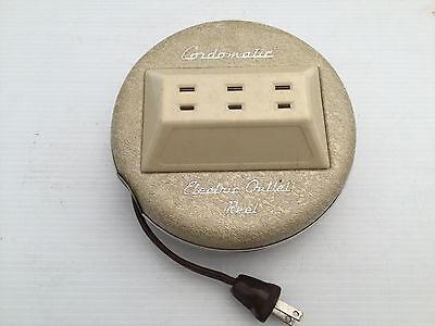 Vintage Electrical Outlet Cord Reel by Cordmatic 1960's-1970's