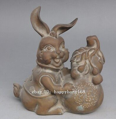 Antique chinese hand-carved brass blessing rabbit embrace gourd statue
