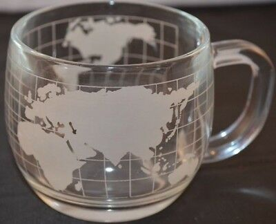 ETCHED CLEAR GLASS NESTLE WORLD GLOBE CUP . (34 Available)