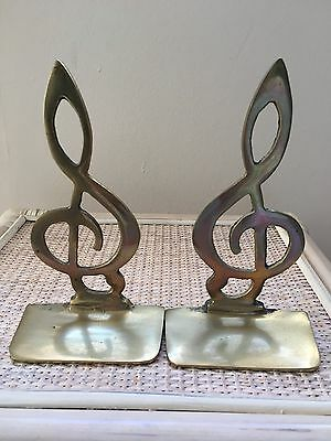 Brass bookends, g clef design