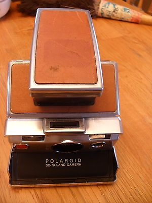 Vintage Polaroid sx-70 Instant Camera with a leather Carring Case