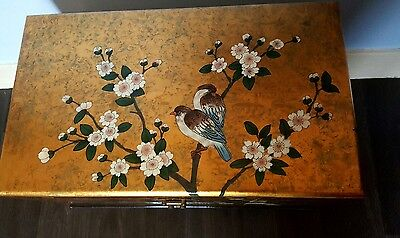 Gorgeous early 20th century ornate gold laquered chinese floor chest