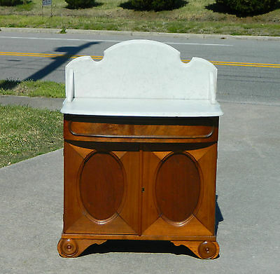 Walnut Victorian Marble Top Washstand with Oval Paneled Doors circa 1865